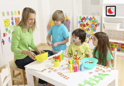 Preschool teacher with children